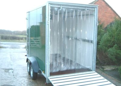 Trailer with ramp and screening